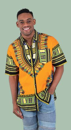 Traditional African Short-Sleeve Dress Shirt - African traditional print shirts in many colors including blue, yellow, orange, green, black, purple, and pink.  Celebrate African culture and history with these traditional African shirts or get them for a Black History Month Event.  Each shirt is covered with the bold and bright traditional patterns and colors of Africa.  #african #africa #traditional #pattern #shirt #mensfashion #mensstyle #style #stylish #blackhistorymonth
