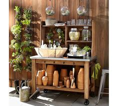 This is actually a potting cart bar??????? Wonder if this vertical garden is actually functional or should I say productive?