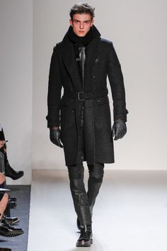 Belstaff continues with their fall 2013 collection as the masters of motorcycle chic. Black dominates the color palette with splashes of brown and midnight blue. With the prevalence of cargo pockets and slim silhouettes,...