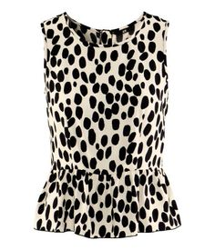 £7 £14.99    Sleeveless woven blouse with a flounce at the hem and a visible zip at the back.