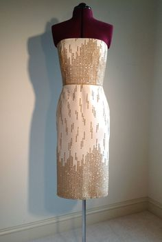 I like the uniqueness and patterning on this.  Women's Strapless White and Gold Dress by allfieruth on Etsy, $72.00