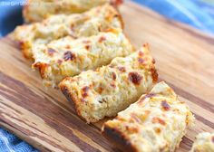 Killer Artichoke Bread Recipe with butter, garlic cloves, marinated artichoke hearts, shredded mozzarella cheese, shredded cheddar cheese, grated parmesan cheese, sour cream, French bread loaves, ground black pepper, salt