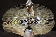 Bead and wire-wrapped silverware. Williams Studio