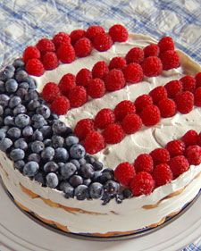 Layers of vanilla wafers and strawberry whipped cream are topped with fresh berries for a salute to the Fourth of July.