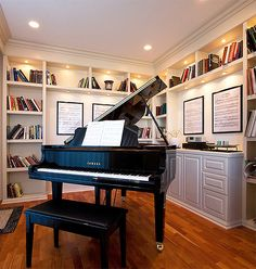 I picked this room because I love the books in the background and the piano in the center. The focal point is the piano. My eyes first found the piano, then the books on the top shelf, and then the posters. Grand Piano Room, Piano Room Decor, Home Studio Musik, Music Studio Room, Home Music Rooms, Home Library Rooms, Home Renovation, Piano Living Rooms, The Piano