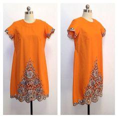 60's vintage / vibrant orange / mod shift dress / embroidered flower detail