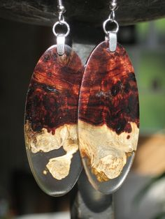 So Here is a wood that is incredibly rare and unusual. To make it more interesting, I used the Burl with heart wood and sap wood contrast and added a clear resin to set off the whole thing.      The earring pendants measure 2 inches by 7/8 inches