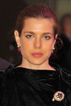 Charlotte is wearing a cameo brooch that belonged to Princess Grace.
