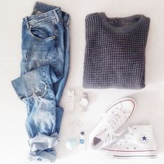 Grey sweater, ripped light wash jeans and white converse