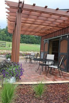 Pergola for patio that attaches to house; would like more of a curved shape though
