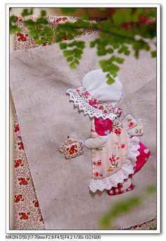 My grandmother hand appliques these cute little ladies and she taught me how a few years ago now I machine applique :)