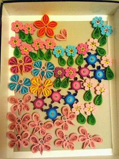 Quilling magnets as wedding and baptism favors: butterflies, flowers and tortoises
