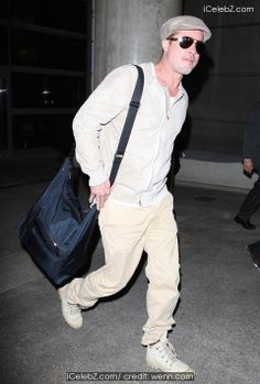 Brad Pitt  Brad Pitt arrives at Los Angeles International Airport (LAX) carrying a messenger bag http://www.icelebz.com/events/brad_pitt_arrives_at_los_angeles_international_airport_lax_carrying_a_messenger_bag/photo2.html