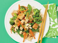 Chicken, Broccoli, and Candied Cashew Stir-Fry - This method of candying cashews also works well for walnuts and pecans. Microwaving the vegetables helps cut down on cooking time and also preserves more of their vitamins.