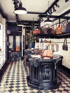 PROPERTY OF...| HIP SHOP | BAGS and ACCESSORIES |The Property Of... Flagship Store is located in Amsterdam, on Herenstraat 2 in the cozy Jordaan area. The interior of the store clearly shows the brand's origins in cafe culture: the store's focal point is a beautiful bar which doubles as a cash register, while the antique tiles and mirrors give the space a homely and cozy atmosphere. Enjoy a cup of coffee in our hip store and have a look at our products :) | https://thepropertyof.com