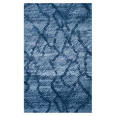Showcasing an abstract motif and rich blue palette, this Turkish-loomed rug highlights your home with contemporary style.   Product...