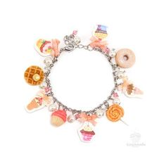This scented Charming Candies Bracelet features miniature sweet treats like cupcakes, ice-cream cones, donuts and waffles and SMELL like a candyland filled with strawberry, waffles and bubblegum!