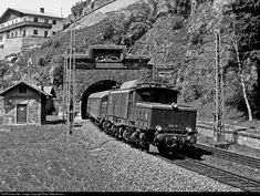 OBB former Deutsche Reichsbahn wartime Co-Co electric No 1020.38 (ex DRG E94 100) leaves the Arlberg Tunnel at St.Anton with an eastbound travel agents special. Since this photo was taken the tunnel at this end has been re-routed into a new station thus freeing up valuable land for development. The engraved stonework above the tunnel mouth with the emperor 'Franz Joseph' on it is now displayed beside the road entrance to the new station.