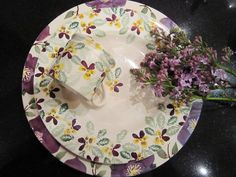 Emma Bridgewaterr Hellebore & yellow pansy. Large plate is a sample