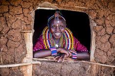 A young #Maasai girl in ceremonial dress. Photo by Matt Brandon, shot on Fuji Xpro1, 35mm lens, f1.4. #thekilgorisproject www.kilgoris.org #kenya
