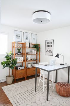 Get your home office organized with secret storage! Use containers, covered boxes, and decorative items from HomeGoods to keep your items organized, yet on-hand at a moment's notice! (Sponsored Pin)