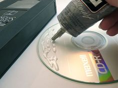 Make a bookend with old VHS tape and a CD
