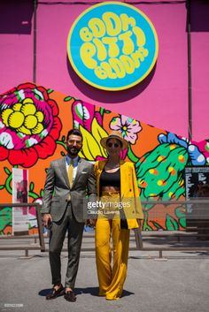 Bugse Kam in a yellow tailleur and Melik Kan, are seen during Pitti Immagine Uomo 92. at Fortezza Da Basso on June 13, 2017 in Florence, Italy.