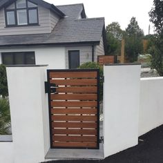 """Modern front garden gate from our """"Kingston"""" collection. Combining the strength of metal with the finest, hand selected iroko hardwood timber. Simple wax finish set within a black frame. Fitted lock and handle. Fence Gate Design, Front Gate Design, House Gate Design, Backyard Gates, Garden Gates And Fencing, Driveway Gate, Gate Designs Modern, Modern Fence Design, Wooden Gate Designs"""