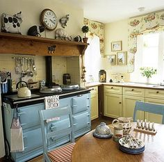Cottage kitchen with powered blue aga. Like the shelf! Aga Kitchen, Kitchen Dining, Kitchen Decor, Cozy Kitchen, Cottage Kitchens, Home Kitchens, Country Kitchens, Aga Stove, Vintage Stoves