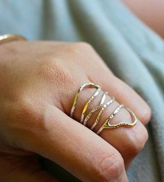 This freeform ring is handmade from sterling silver or gold that has been hammered down to create a unique, textured pattern.