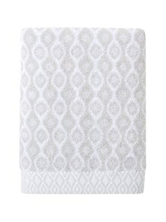 Volute is tinted in contemporary silver grey and plays upon the masculine-feminine elements on this bath towel.