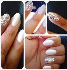Beginning of my oval nail journey with a whole lotta diamonds of different sizes...love white all year around!