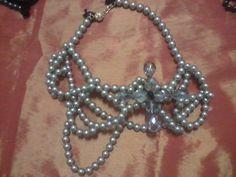 Collana perle multifilo intrecciati con 8 cristalli fumé a formare un meraviglioso oggetto di design staccabile ed utilizzabile come spilla