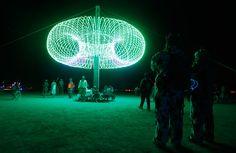 People explore an art installation in the Black Rock Desert of Nevada, on September 2, 2012. (Reuters/Jim Urquhart)