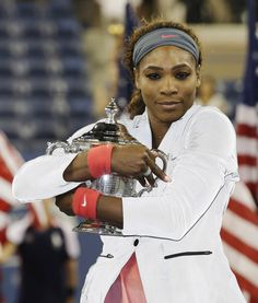 Serena Williams hugs the championship trophy after defeating Victoria Azarenka, of Belarus, during the women's singles final of the 2013 U.S. Open tennis tournament, Sunday, Sept. 8, 2013, in New York. (AP Photo/Darron Cummings)