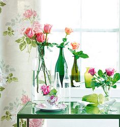 green bottles and flowers