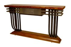 French Art Deco iron & steel trimmed console table with a mahogany base supporti