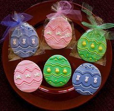 Easter decorated sugar cookies. Royal icing. Green, blue, pink, yellow, white. Polka dots. Stripes. Easter egg.