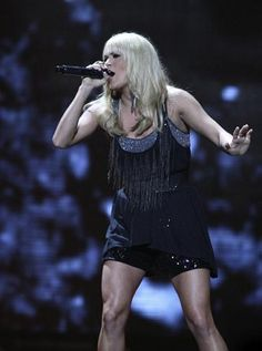 carrie underwood;ok...look at those leg muscles! Her legs are amazing!