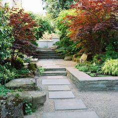 Interesting stone retaining wall with lush landscaping