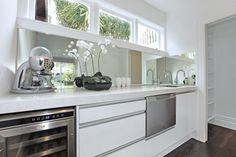 Scullery open behind kitchen