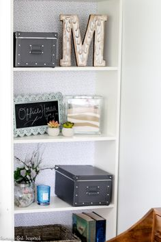 Take your IKEA Gersby bookcase from basic to beautiful with this tutorial on how to upgrade a bookcase with wrapping paper.