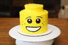 Lego cake I made for my 5 year old. I cooked four 6 inch cakes. Stacked the first three up with frosting in between the layers. For the top, I used the lid of a big jar of peanut butter to trace a smaller circle. Then I had my son pick his favorite face out of the dozens of Lego guys he has and used that on the cake.