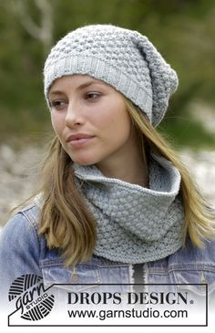 The set consists of: Knitted hat and neck warmer with blackberry pattern. Sizes S - XL The set is worked in DROPS Nepal.
