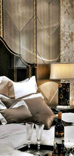 luxury interiors | bedhead | black with gold | wall panels | leather and laquered panels