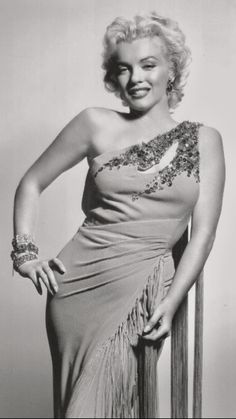 Marilyn💋 wears off the shoulder orange evening gown with beaded embellishments during  publicity photo session for  Twentieth Century Fox Studios