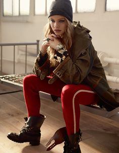 Red Legging with combat boots, green parka and gray beanie.