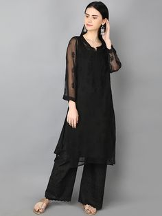 Ada Hand Embroidered Black Faux Georgette Lucknowi Chikankari Kurti With Slip- A165598 offers a comfortable and relaxed silhouette to the wearer #AdaChikan #chikankari #handembroidery #handcrafted #chikan #traditional