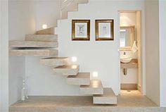 Neste projeto da arquiteta Maria Fernanda, da MF Arquitetos, a escada de conc...