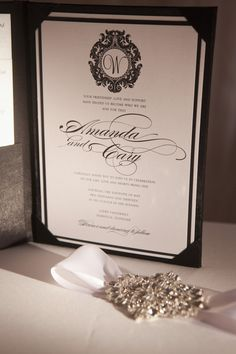 Elegant black and white wedding invitation. With red in the border.